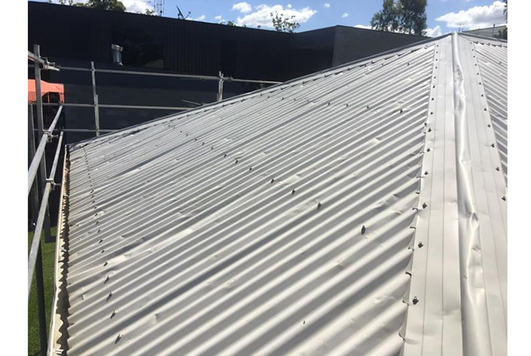 Damaged-Metal-Roof-Restoration